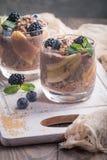 Chocolate chia pudding with banana. Vegan dessert, chocolate chia pudding with banana, berries and mint Stock Image