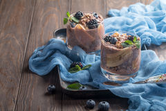 Chocolate chia pudding with banana. Vegan dessert, chocolate chia pudding with banana, berries and mint Royalty Free Stock Photo