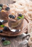 Chocolate chia pudding with banana. Vegan dessert, chocolate chia pudding with banana, berries and mint Stock Images