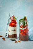 Chocolate chia pudding with yogurt and strawberries. Stock Images