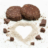Chocolate chia seed cookies with chia heart. Homemade chocolate chia seed cookies with chia seed love heart. Cookies in focus royalty free stock images
