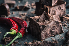 Chocolate and Chili. Black chocolate and chili pepper. Dark chocolate with red chilli pepper. Blocks Bitter chocolate with chili Stock Photography