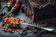 Chocolate and Chili. Black chocolate and chili pepper. Dark chocolate with red chilli pepper. Blocks Bitter chocolate with chili Stock Photography