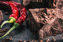 Chocolate and Chili. Black chocolate and chili pepper. Dark chocolate with red chilli pepper. Blocks Bitter chocolate with chili Royalty Free Stock Photo