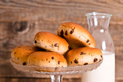 Chocolate chip brioche. Chocolate chip brioche bun on wooden table royalty free stock photography