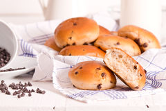 Chocolate chip brioche. Chocolate chip brioche bun on wooden table stock image