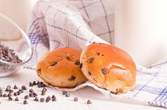 Chocolate chip brioche. Chocolate chip brioche bun on wooden table royalty free stock photo