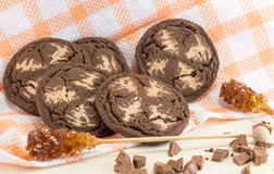 Chocolate chip brown cookies on orange tablecloth Royalty Free Stock Images
