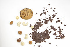 Chocolate Chip Cookie. A chocolate chip cookie on a white background with chocolate chips and nuts Royalty Free Stock Image