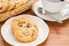 Chocolate chip cookie with almond and coffee cup Stock Image