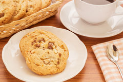 Chocolate chip cookie with almond and coffee cup, Filtered image Royalty Free Stock Photography
