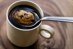 Chocolate Chip Cookie in the Coffee with Spoon. Stock Photos