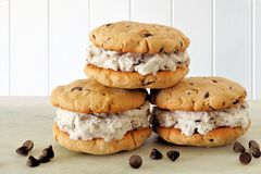 Chocolate chip cookie ice cream sandwiches over white wood stock image