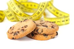 Chocolate Chip Cookie with Measuring Tape Isolated on White, Diet Concept.  stock photos