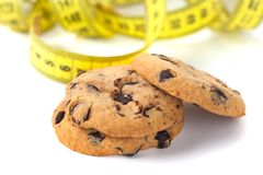 Chocolate Chip Cookie with Measuring Tape Isolated on White, Diet Concept.  stock photo