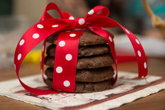 Chocolate chip cookie with napkin and red silk bow with white dots Royalty Free Stock Photo