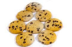 Chocolate chip cookie`s whiting for someone sweet. A cookie is a baked or cooked food that is small, flat and sweet. It usually contains flour, sugar and some Stock Photo