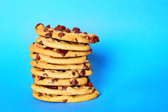 Chocolate chip cookie stack on blue Royalty Free Stock Photos