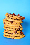 Chocolate chip cookie stack on blue vertical. Shot of chocolate chip cookie stack on blue vertical Royalty Free Stock Images