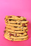 Chocolate chip cookie stack on pink vertical Royalty Free Stock Photos