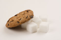 Chocolate chip cookie and sugar cubes Royalty Free Stock Photo