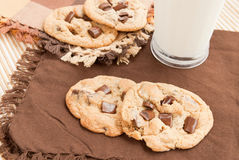 Chocolate Chip Cookies. Homemade chocolate chip cookies served with a glass of milk. Selective focus and shallow DOF. Shot with natural light Stock Photography