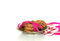 Chocolate chip cookies. Tied in a ribbon with candy canes, celebration concept royalty free stock photos