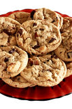 Chocolate chip cookies. On red glass plate Royalty Free Stock Image