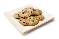 Chocolate chip cookies. A view of a plate of freshly baked chocolate chip cookies on a square white plate and a white background Royalty Free Stock Photo