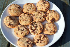Chocolate chip cookies or biscuits on a plate or dish. Stock Photo