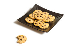 Chocolate chip cookies on a black plate on white backgr Stock Photography