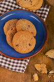 Chocolate chip cookies on  a blue plate. Royalty Free Stock Photography