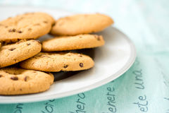 Chocolate chip cookies on blue table set Stock Photos