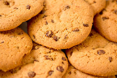 Chocolate chip cookies on blue table set Royalty Free Stock Photography