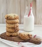 Chocolate chip cookies and bottle of milk. Stock Photo