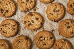Chocolate chip cookies on brown napkin background. Sweet biscuits. Homemade pastry royalty free stock image
