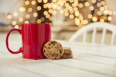 Chocolate chip cookies and christmas lights Stock Images