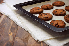 Chocolate chip cookies. Close-up. Festive aromas. Home cosiness. Homemade chocolate on the baking sheet, close-up. Shallow depth of abrasion. The selected focus royalty free stock photos