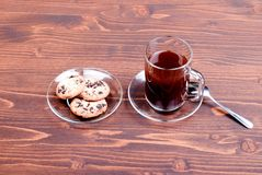 Chocolate chip cookies with coffee on the board top view Stock Photography