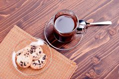 Chocolate chip cookies with coffee on the board top view Royalty Free Stock Photography