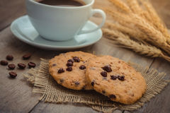 Chocolate chip cookies and coffee cup Royalty Free Stock Image