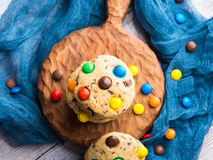 Chocolate chip cookies with colorful candies. Top view Royalty Free Stock Image