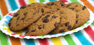 Chocolate chip cookies on colourful background Stock Photo