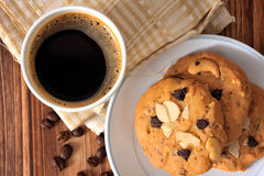 Chocolate chip cookies and a cup of black coffee Royalty Free Stock Photo