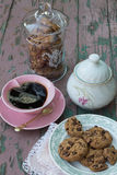 Chocolate Chip Cookies and a Cup of Black Coffee. Chocolate Chip Cookies on a Plate, a Glass Cookie Jar, a Cup of Black Coffee and a Porcelain Sugar Bowl on a Royalty Free Stock Photo