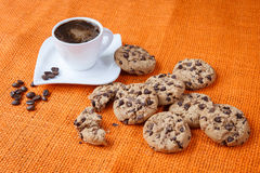 Chocolate chip cookies and cup of coffee shot Stock Images