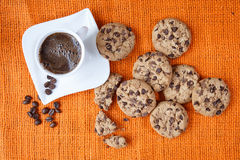 Chocolate chip cookies and cup of coffee shot Stock Photography
