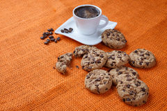 Chocolate chip cookies and cup of coffee shot Royalty Free Stock Photo