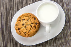 Chocolate chip cookies and cup of milk Royalty Free Stock Photo