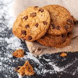 Chocolate chip cookies on dark background  with place for text. Stock Photos